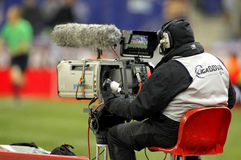 Television camera broadcasting football match Royalty Free Stock Images