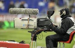 Television camera broadcasting football match Royalty Free Stock Image