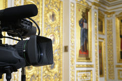 Television camera at the church. TV broadcast camera against the background of church decoration Orthodox Church royalty free stock images