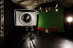Television Camera Lens in Green screen studio Royalty Free Stock Photography