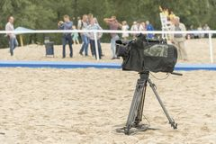 Television camera on the river beach. Camera for taking pictures on the beach. royalty free stock photography
