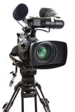 Television Camera on Tripod against white background. Close-up of a Digital HD Television Camera and Tripod isolated on a white background. Shallow depth of Royalty Free Stock Photo