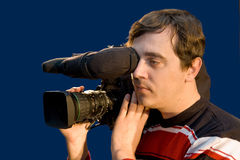 Television cameraman. The television cameraman with the chamber on a shoulder Stock Image