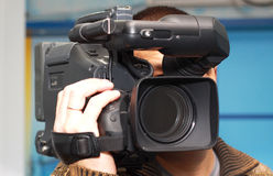 Television cameraman. The television cameraman with the chamber on a shoulder Stock Images
