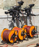 Television cameras and cable reels Royalty Free Stock Images