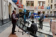 The television crew is reporting from the Central Electoral Commission during the elections. Royalty Free Stock Images