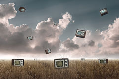 Television falling. Many television falling to the sky in a meadow Stock Images
