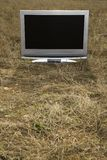 Television in grass. Stock Photo