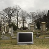 Television in graveyard. Stock Images