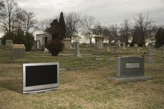 Television in graveyard. Royalty Free Stock Photo