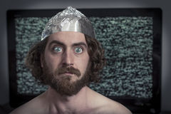 Television Hypnotized. Brain washed crazy man is hypnotized by television program stock image