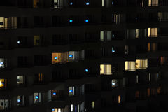 Television at night. Building at night with its residents watching tv stock image