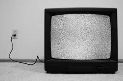 Television plugged into wall Royalty Free Stock Images