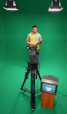 Television presenter on green screen Royalty Free Stock Image