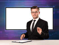 Television program host with big copy screen in his back Royalty Free Stock Images