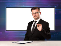 Television program host with big copy screen in his back Stock Images