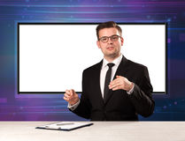 Television program host with big copy screen in his back. Concept Stock Images