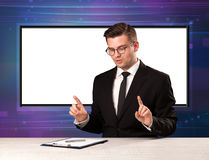 Television program host with big copy screen in his back. Concept Stock Photography