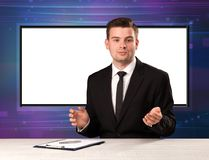 Television program host with big copy screen in his back. Concept Stock Photos