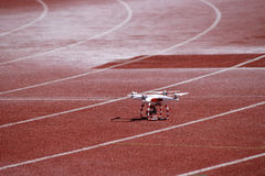 Television quadcopter on a treadmill Royalty Free Stock Images