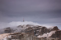 Television relay in Carpatians. Winter view over Costila television relay over clouds Royalty Free Stock Photos