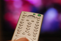 Television remote control. A finger press buttons on a tv remote Stock Image