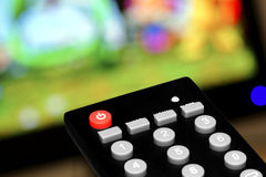 Television remote control. Remote control television with the background screen Stock Photography