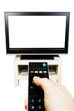 Television and remote control. Modern television with remote control in use stock photography