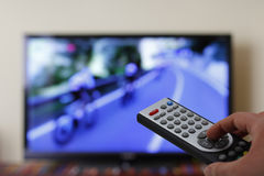 Television remote control in the hand, zapping Stock Image
