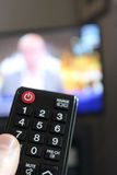 Television Remote Control in Human Hand Royalty Free Stock Images