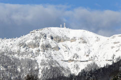 Television repeaters on the mountain top with snow Stock Images