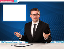 Television reporter telling breaking news at his studio desk wit Royalty Free Stock Photo