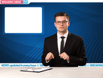 Television reporter telling breaking news at his studio desk wit Royalty Free Stock Image