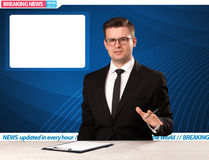 Television reporter telling breaking news at his studio desk wit Stock Image