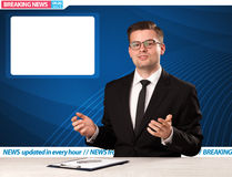 Television reporter telling breaking news at his studio desk wit Royalty Free Stock Images