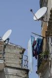 Television satellite antennas in the city Stock Photos