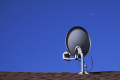 Television Satellite Dish. On clear blue sky Royalty Free Stock Photos