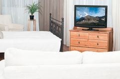 Television set in bedroom Royalty Free Stock Photography