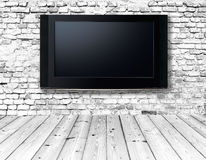 Television set on an old wall Stock Photos