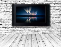 Television set on an old wall royalty free stock photography