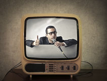 Television showing a showman presenting Stock Image