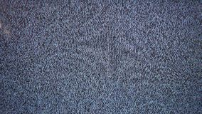 Television signal tv noise screen with static caused a by flicker bad reception stock footage