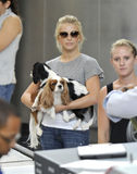 Television star Julianne Hough with dogs at LAX. LOS ANGELES-SEPTEMBER 19: Television presenter Julianne Hough with her dogs at LAX airport. September19 in Los Stock Images