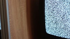 Television static noise black white. Noise on the TV is reflected in the mirror stock video footage