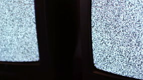 Television static noise black white. Noise on the TV is reflected in the mirror stock video