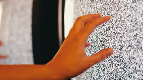 Television static noise black white. Noise on the TV is reflected in the mirror woman`s hand slowly touches to noise on TV stock footage