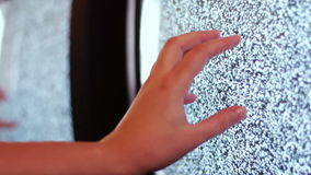 Television static noise black white. Noise on the TV is reflected in the mirror woman`s hand slowly touches to noise on TV like horror movies stock video