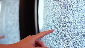 Television static noise black white. Noise on the TV is reflected in the mirror woman`s hand slowly touches to noise on TV like horror movies stock video footage