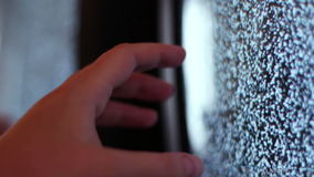 Television static noise black white. Noise on the TV is reflected in the mirror woman`s hand touches to noise on TV stock video