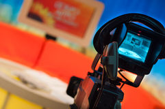 Television studio. Video camera viewfinder - recording show in TV studio - focus on camera Royalty Free Stock Photos